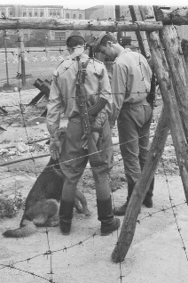 East German VOPOs guarding workers building the Berlin Wall